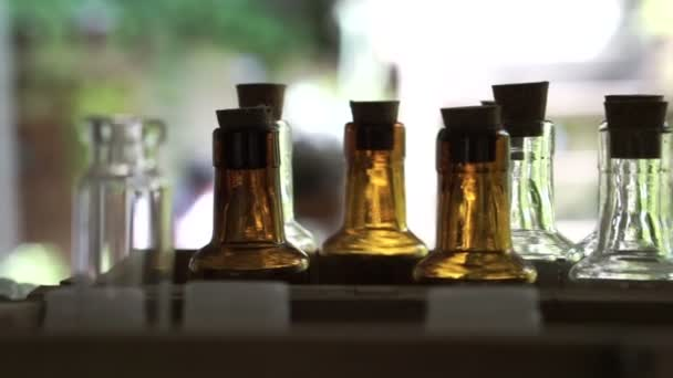 Homemade craft essence perfume or oil fragrant container bottles in rows