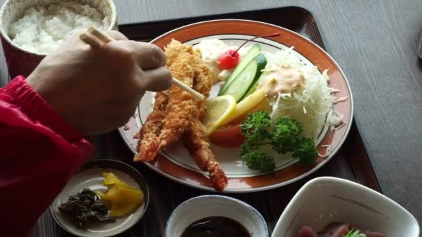 Using Chopstick Eating Japanese Shrimp Or Prawn Tempura Food Meal