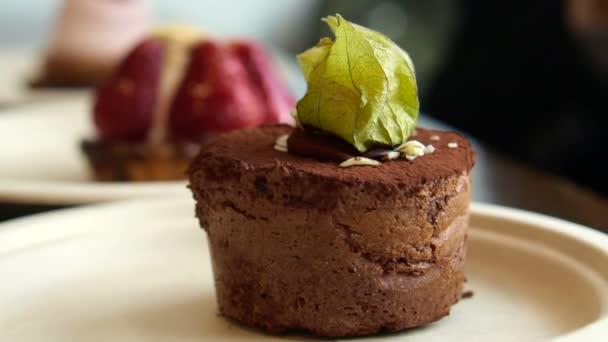Three cakes at different focus. lava chocolate cake, strawberry tart and cream raspberry bake