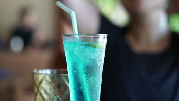 Blue ocean mocktail, alcohol free cocktail close up. Sparking soda texture in turquoise beverage
