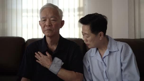 Asian senior couple do self blood pressure check