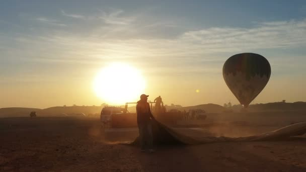 Luxor, Egypt - 22 Dec 2019: Egytian team collecting balloon after tourist attraction