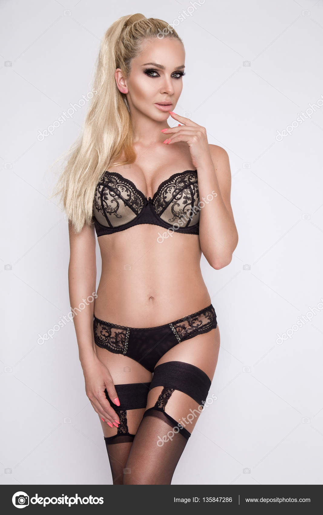 beautiful woman blonde long hair green eyes in black sexy lingerie