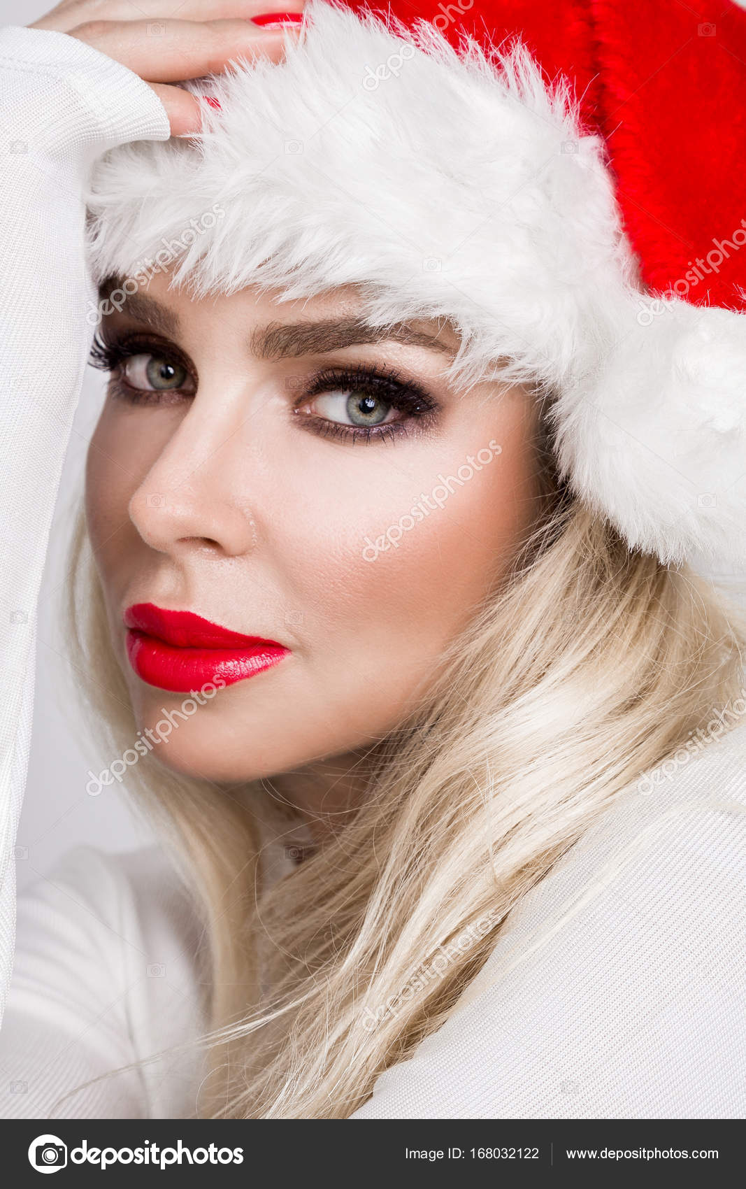 Beautiful Blonde Female Model In A Santa Claus Hat Christmas Mood Of Beautiful Woman Stock Image