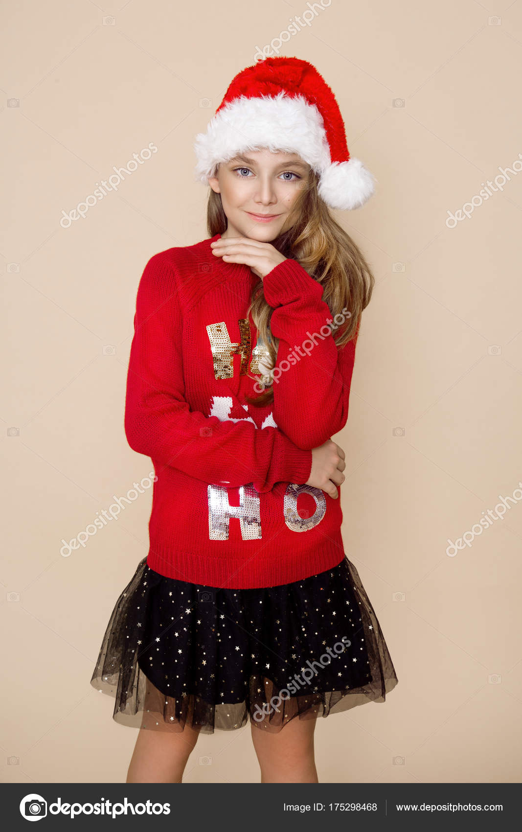 33267ee26765 Beautiful Cute Little Girl Wearing Red Christmas Sweater Red Cap– stock  image
