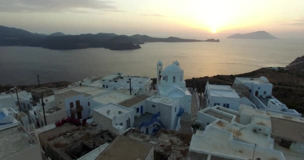 Flight over the town of Plaka at sunset, Milos island Cyclades, Greece