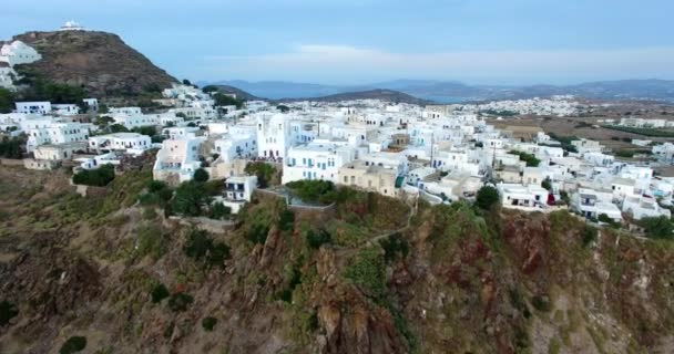 Flight over the town of Plaka with beautiful white houses and churches , Milos island Cyclades, Greece