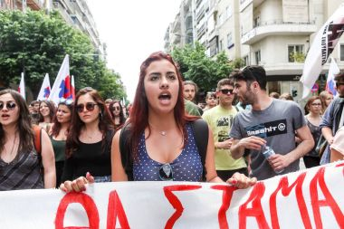 Thessaloniki, Greece - May 17, 2017: Protesters  during a national general strike in Thessaloniki. Greek workers have left work across the country on wednesday for a general strike against austerity stock vector