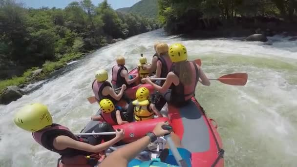 Paranesti, Drama, Greece - July 30, 2019: adventure team doing rafting on the cold waters of the Nestos River in Paranesti. Nestos river is one of the most popular among rafters in Greece. slow motion