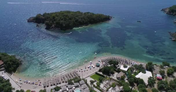 Aerial drone bird's eye view of of Agia Paraskeui Beach with turquoise sea in complex islands in Parga area, Ionian sea, Epirus, Greece