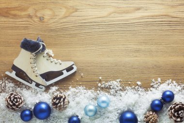 Winter Background With Snow And Ice Skates