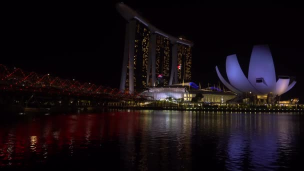 SINGAPORE - February 25, 2020: Views from Marina Bay Sands, Helix Bridge  Art Science Museum at night, without laser show