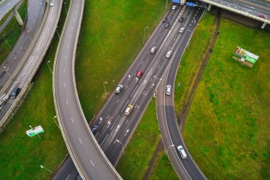 Aerial view at junctions of city highway. Vehicles drive on road stock vector