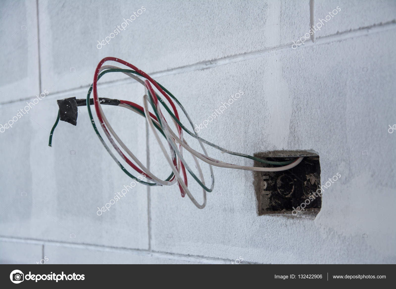 electric system on wall in construction site ,outlet with iron pipes ...