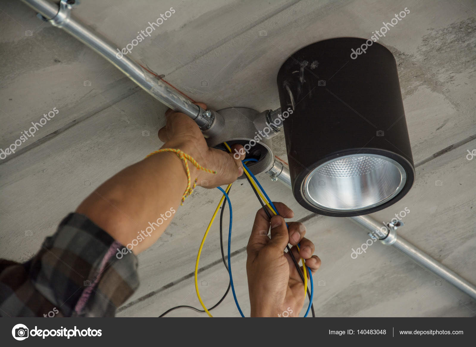 Electrical Cable In Galvanized Conduit Pipe Connection And Ceili Electricwireconduitjpg Stock Photo