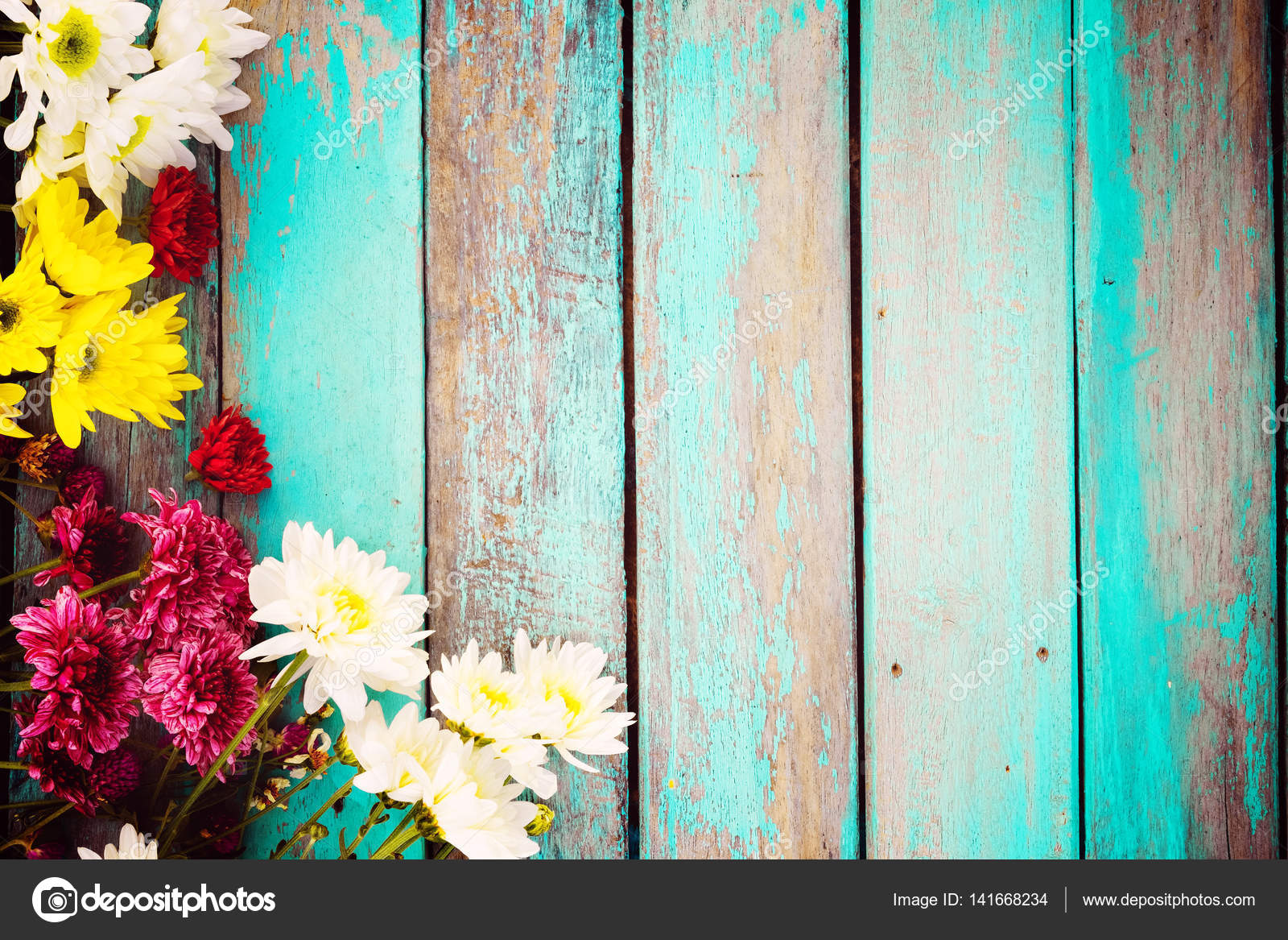 Colorful flowers bouquet on vintage wooden background — Stock Photo ...