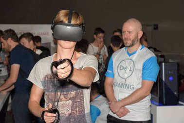 A visitor is playing a virtual reality game with oculus rift
