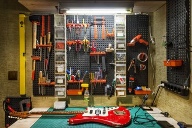 Luthier's Workbench With A Red Guitar