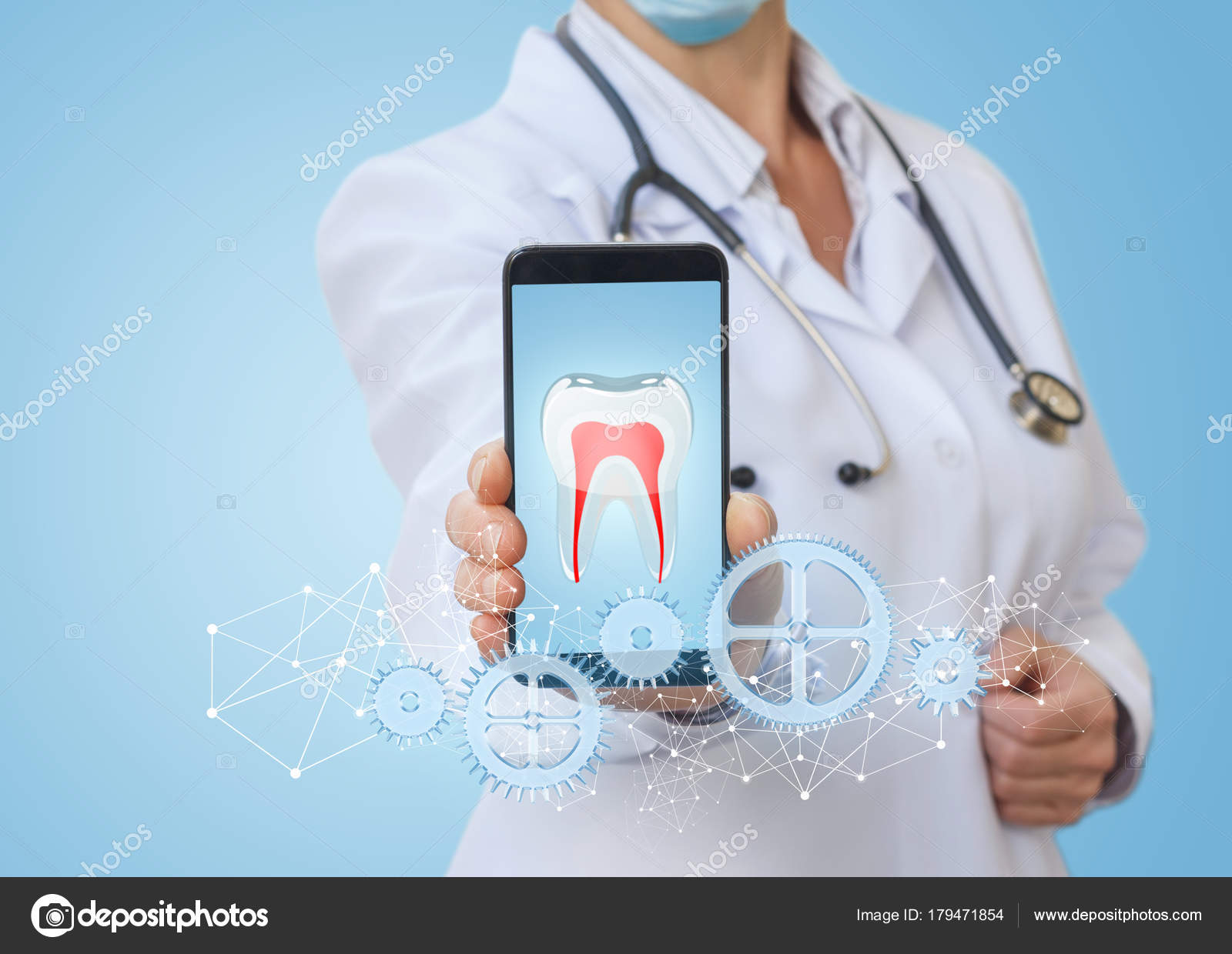 medic in the phone app shows the treatment of the teeth stock