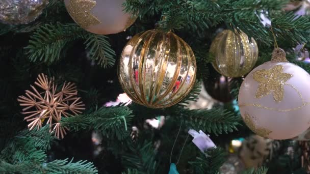 Christmas Toys Glittering on Branches of Tree