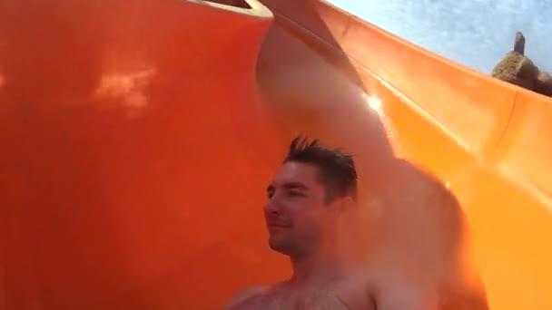 Man Taking Selfie While Floating a Water Slide