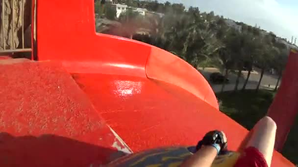 Gopro of Man Sliding From Water Slide