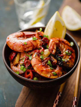 Large grilled BBQ shrimp with sweet chili sauce, green onion and