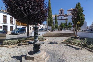 Barefoot Square next to the Church of Santa Cecilia, Ronda, Andalusia, Spain.