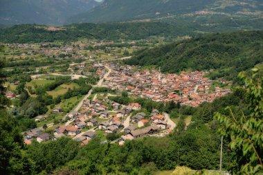 Aerial view of small italian village Farra D'Alpago in alps near Santa Croce lake.