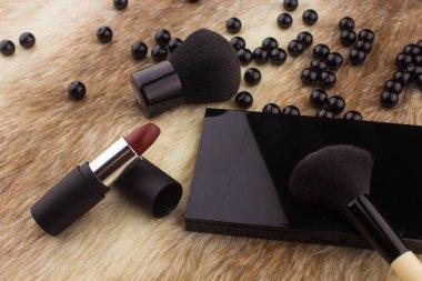 Makeup tools on Fur background
