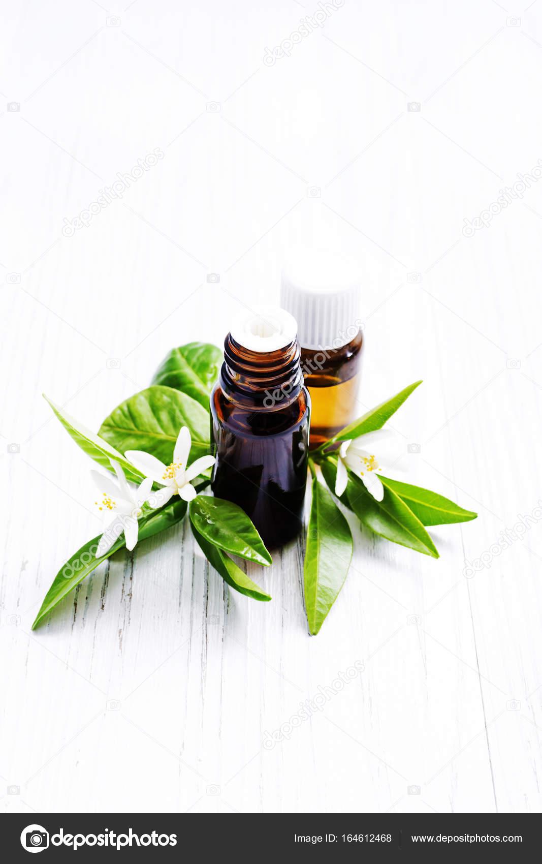 Neroli essential oil stock photo laroinovaolga 164612468 neroli citrus aurantium essential oil in a brown glass bottles and fresh white flowers photo by laroinovaolga mightylinksfo