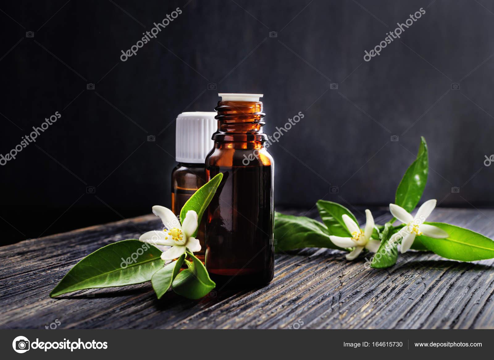 Neroli essential oil stock photo laroinovaolga 164615730 neroli citrus aurantium essential oil in a brown glass bottles and fresh white flowers photo by laroinovaolga mightylinksfo