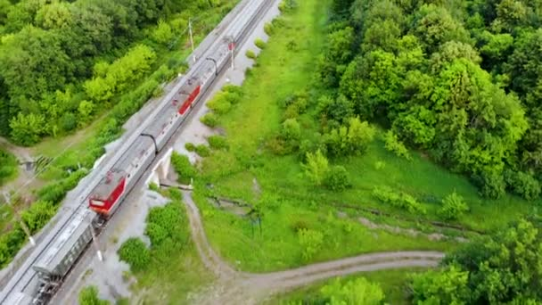 Aerial shot of freight train that travels by rail. Taken by drone at sunset