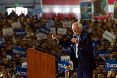 San Jose, CA - March 1, 2020: Presidential candidate Bernie Sanders rally in San Jose, CA. Crowd excitedly waving Bernie signs.