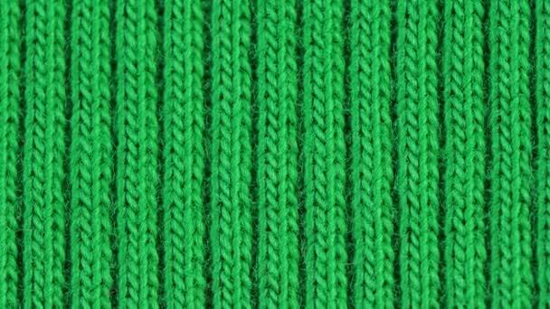 Textil háttér - zöld pamut szövet mez bordázat szerkezet. Makrofelvétel.