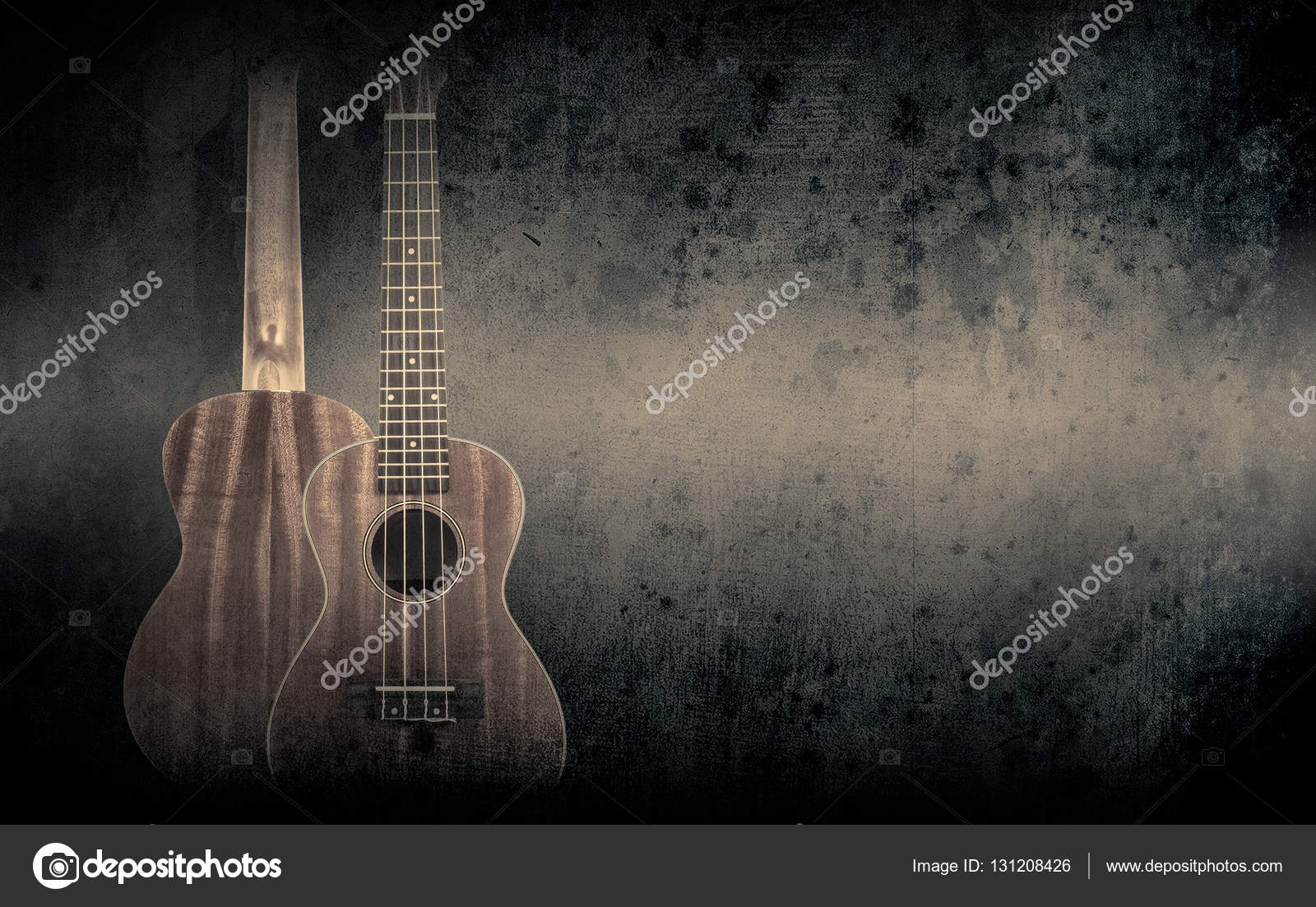 Part Of A Orange Acoustic Guitar On Black Background Stock Photo