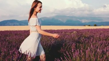 Woman walking through lavender field