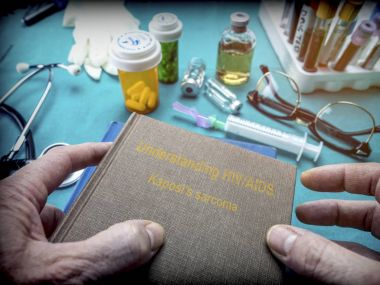 Doctor Holds Book of  HIV / AIDS sarcoma kaposi In A Hospital, conceptual image