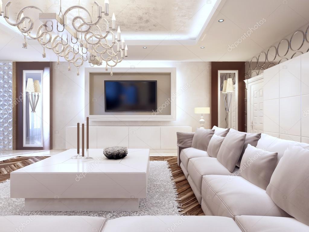 Moderne woonkamer in witte kleuren met geïntegreerde opslag voor t ...