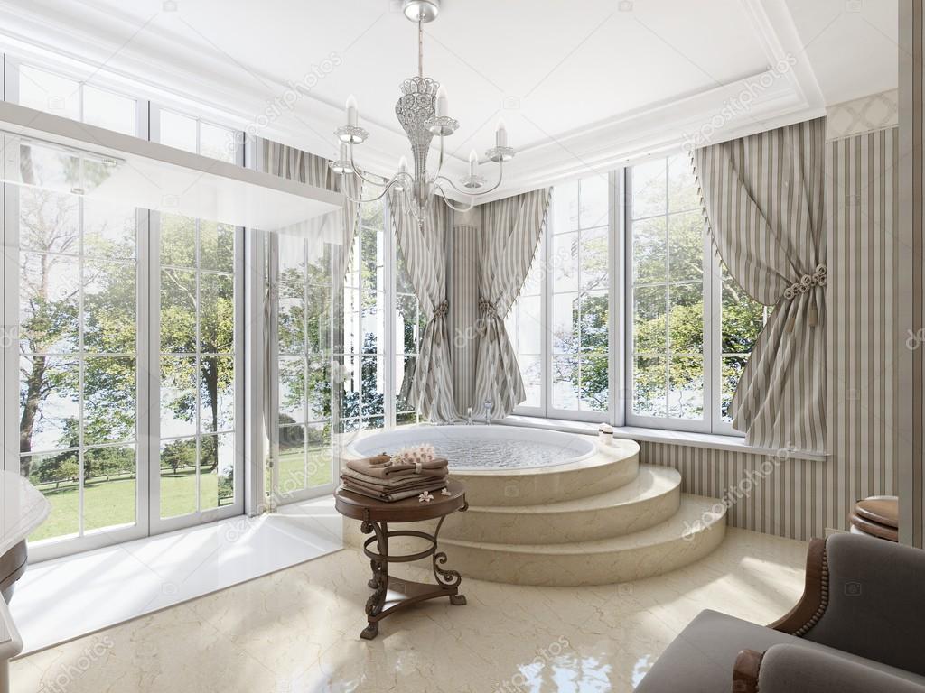 Grande baignoire ronde dans la salle de bain dans un style classique ...