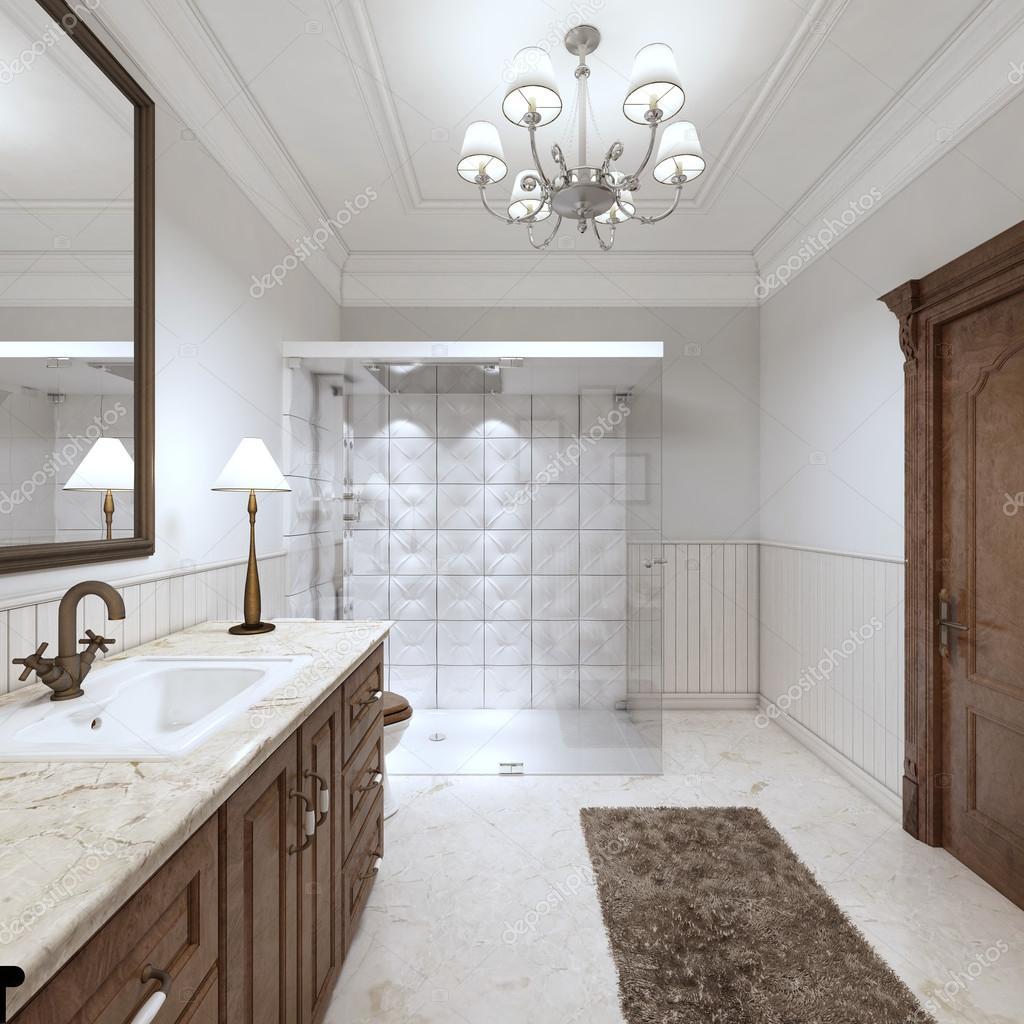 Bagni luminosi in stile inglese con ampia doccia in vetro\u2013 immagine stock