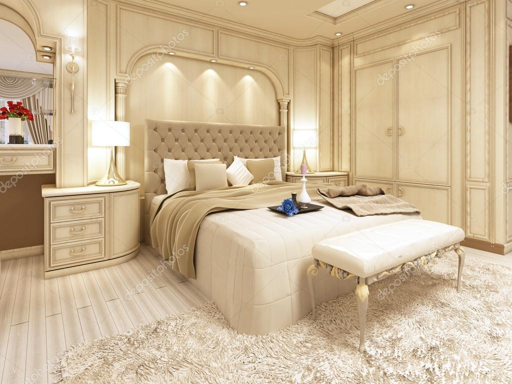 Luxury bed in a large neoclassical bedroom with decorative niche ...