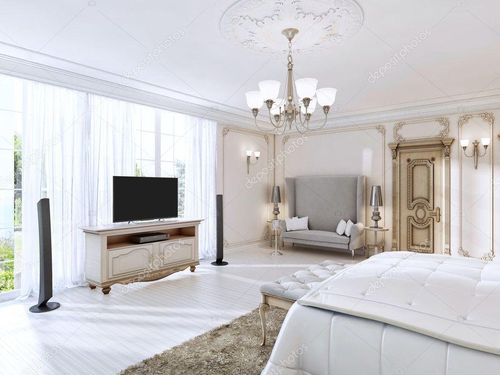 Lussuosa camera da letto con un grande divano e Mobile Tv la grande ...