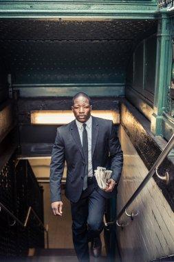 Confident businessman exiting subway station