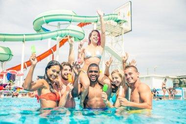 Friends having fun in water park
