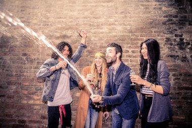 Friends uncorking champagne bottle
