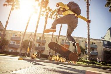 Skater boy on street in Los angeles