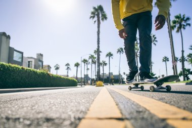 Skater boy on street in Los angeles