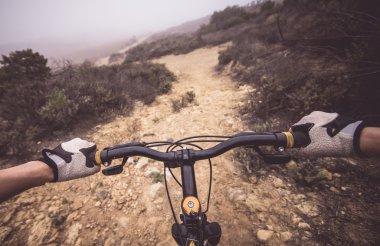 Mountain bike and human hands
