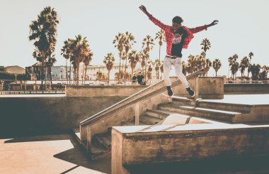 Skateboarder in action at skate park
